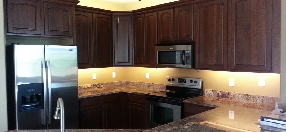 A simple cabinet color refinishing job add good lighting and you have a complete new look