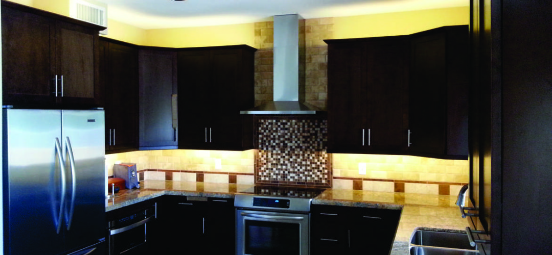 Great led lighting effects under the cabinets bring a back splash to life and add functionality